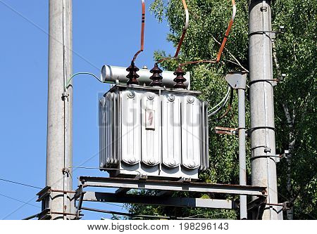 product - Old electrotechnical transformer and concrete column