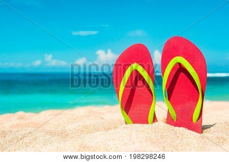Beautiful beach. Beach sandals on the sandy coast. Summer holiday and vacation concept. Tropical beach.