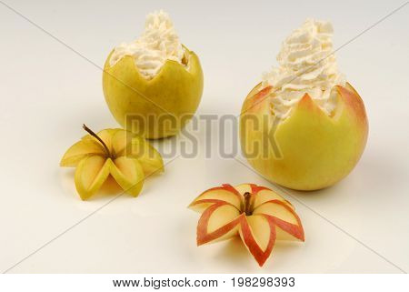 Two apples stuffed with whipped cream, decoration