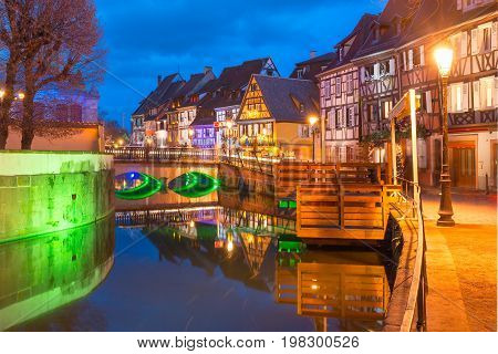 Traditional Alsatian half-timbered houses in Petite Venise or little Venice, old town of Colmar, decorated and illuminated at christmas time, Alsace, France