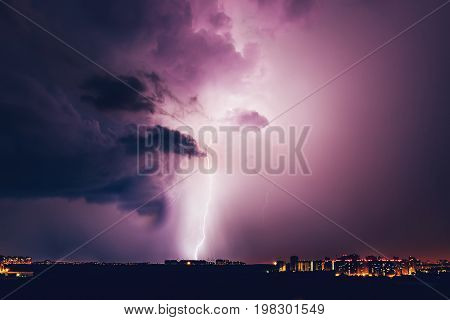Lightning hits the house, Lightning storm over Voronezh city in purple colour