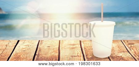 White cup over white background against scenic view of beach