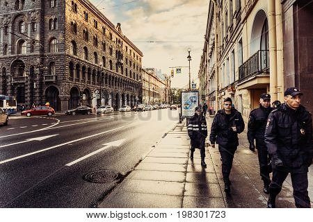 Saint Petersburg, RUSSIA - June 1, 2017: The historical center or downtown of St. Petersburg, houses, architecture, a detachment of policemen is walking along the sidewalk