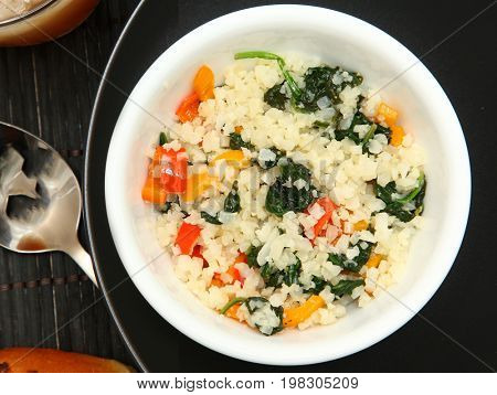 Paleo Hot Vegetable Salad with Riced Cauliflower substitute.