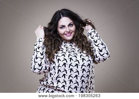 Happy plus size fashion model fat woman on beige studio background overweight female body