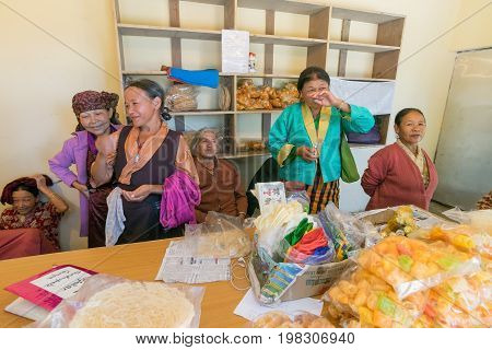 NAMCHI SIKKIM INDIA - OCTOBER 20 2016 : Sikkimese elderly women shop owners sharing a laugh - at Namchi Sikkim . They are very hard working and support their families at even old age.