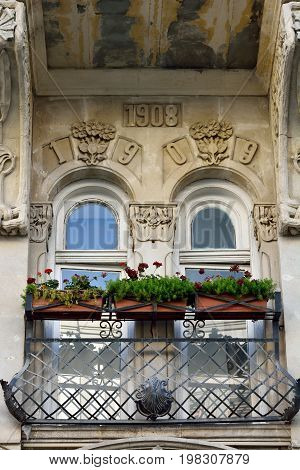 Baku, Azerbaijan - July 23, 2017. Balcony of architectural building in downtown Baku, with flowers and ornaments.