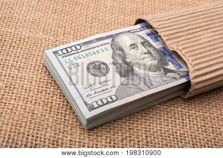 Banknote Bundle Of Us Dollar Wrapped In Paper