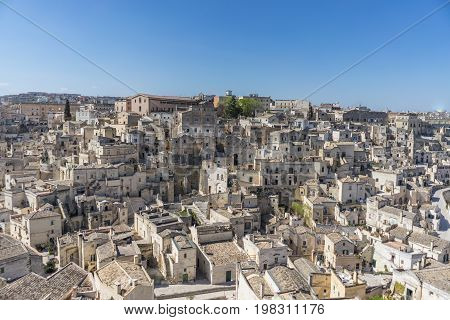 amazing panorama view of ancient ghost town of Matera (Sassi di Matera) in bright sun shine summer with blue sky south Italy.