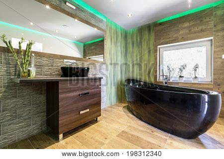 Modern Bathroom With Green Reflections