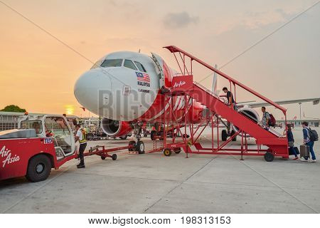 KUALA LUMPUR, MALAYSIA - MAY 02, 2014: people boarding at AirAsia aircraft at the airport. AirAsia is the largest airline in Malaysia by fleet size and destinations