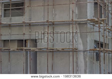 Building Covered With Scaffolding At Construction Site