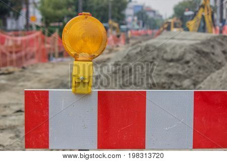 Construction Barrier Sign With Yellow Warning Light