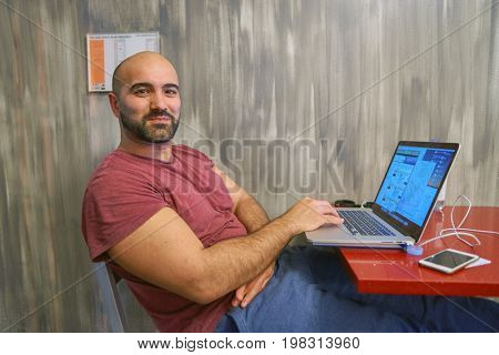 CHICAGO, IL, - CIRCA APRIL, 2016: man use notebook at Chicago Getaway Hostel. Hostels provide budget-oriented, sociable accommodation where guests can rent a bed, usually a bunk bed, in a dormitory.