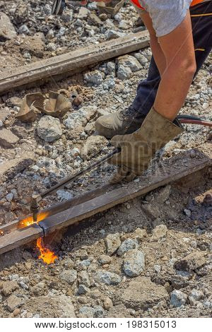 Industrial Worker Cutting A Old Tram Tracks With An Oxy-acetylene Torch