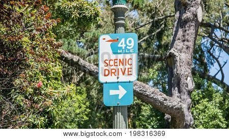 San Francisco CA - September 2014: Road sign for Scenic Drive County Road hanging on a pole in San Francisco