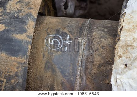 Weld On A Steel Pipe In Trench For Heat System
