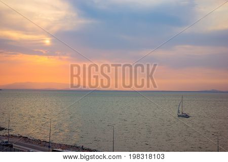 Aegean Sea In The Konak Area Of Izmir Turkey The View During Sunset With A Yacht Floating On The Sea