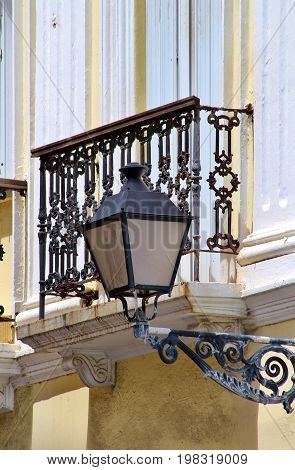 Old wrought iron balconys and lamp posts in Old San Juan Puerto Rico