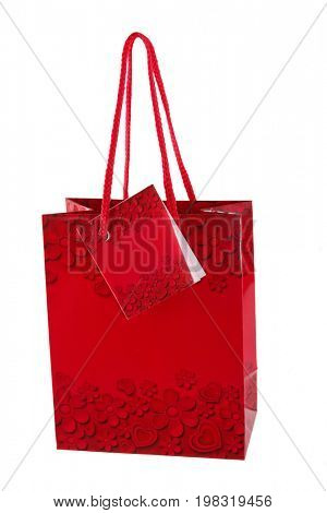 Vibrant red blank paper shopping bag Red bag in the heart, on white background