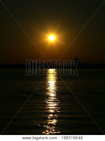 Sun At The Sunset With Reflections On The Water Of The Adriatic