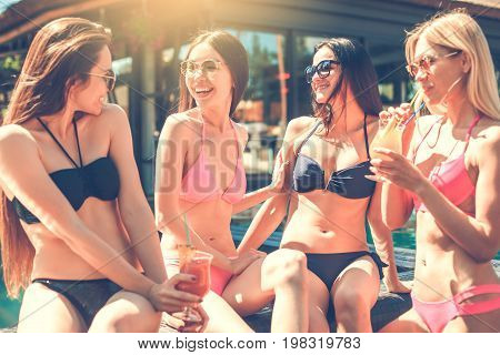 Group of friends in the swimming pool