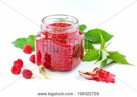 Homemade Homemade Jam. Glass Jar With Raspberry Jam On A White Background. Preserved Berry.