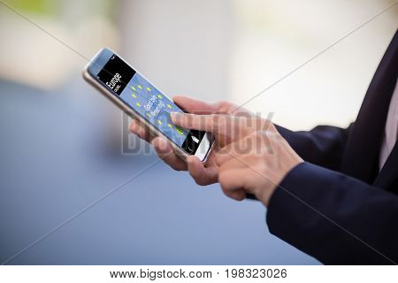Good bye roaming text and European Union flag on mobile screen against businesswoman using mobile phone