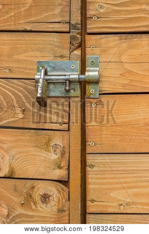 Closed Wooden Door With Padlock And Bolt