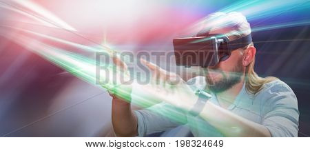 Man pointing while wearing virtual reality glasses against modern table in cafeteria