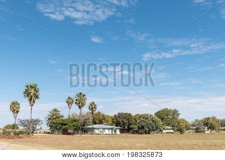KOMBAT NAMIBIA - JUNE 20 2017: A street scene with houses in Kombat in the Otjozondjupa Region of Namibia