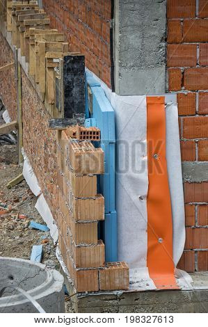 Thermal And Hydro Insulation On Wall At A Building Site