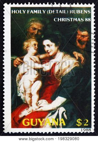 GUYANA - CIRCA 1988: a stamp printed in Guyana shows Holy Family (Detail) Painting by Rubens Flemish Artist circa 1988