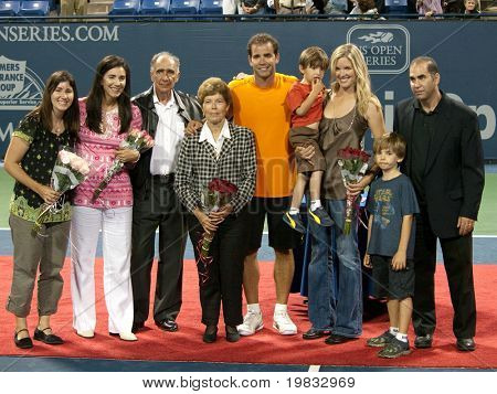 LOS ANGELES, CA. - JULY 27: Pete Sampras and family pose for photographers after his exhibition match at the L.A. Tennis Open July 27, 2009 in Los Angeles.