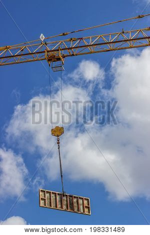 Formwork Element Against Blue Sky, Lifting By Construction Crane
