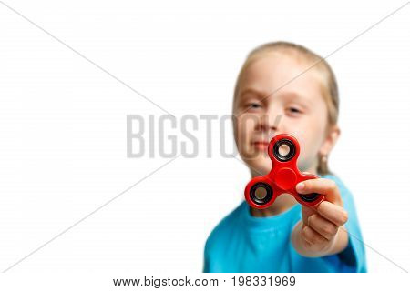 Little Beautiful Girl In Blue T-shirt Is Playing Red Spinner In Hand