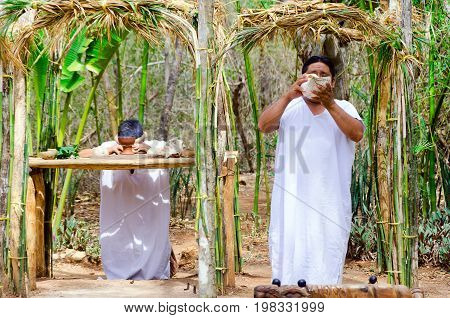 UXMAL MEXICO - FEBRUARY 20: Two men doing a Mayan ceremony in Uxmal Mexico on February 20 2017