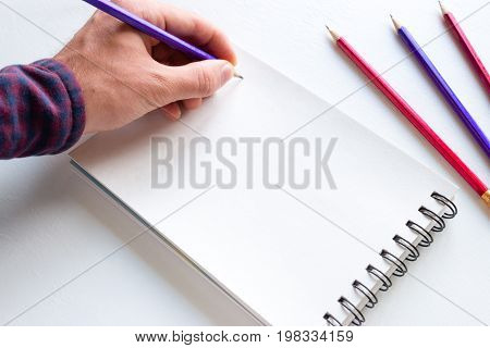 The Left-hander Writes In A Notebook Mockup