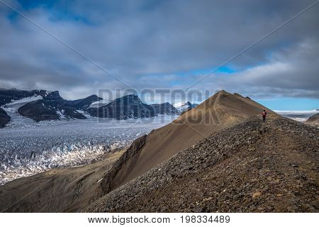Trails in the mountains near a glacier Svalbard