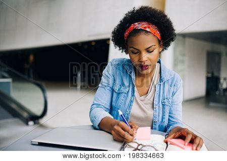 Focused Young African Female Entrepreneur Working In An Office L