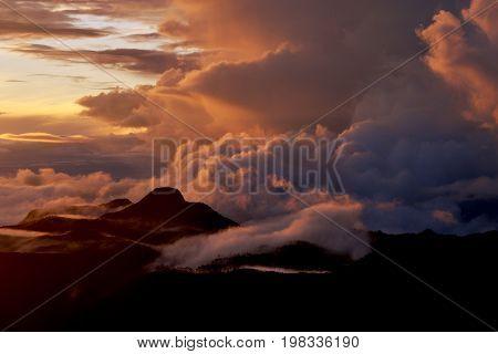 Sunrise on the top of Mount Adam Peak. Rising of the sun on Sri Pada - Sri Lanka. The mountain of butterflies.