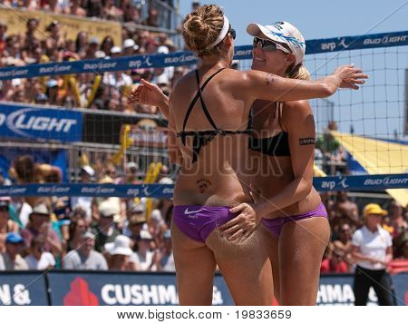 HERMOSA BEACH, CA. - AUGUST 8: Jen Kessy (R) and April Ross (L) vs. Nicole Branagh and Elaine Youngs for the womens final of the AVP Hermosa Beach Open. August 8, 2009 in Hermosa Beach.