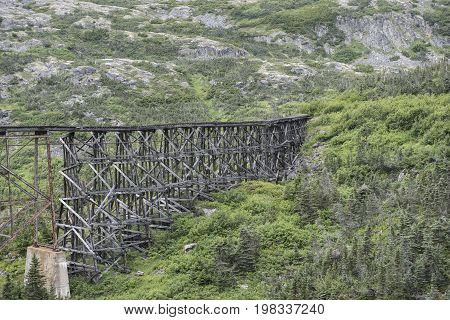 Wooden Train Trestle in Alaska in the mountains