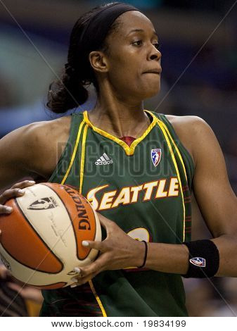 LOS ANGELES, CA. - SEPTEMBER 16: Swin Cash looking to pass the ball during the WNBA playoff game of the Sparks vs. Storm on September 16, 2009 in Los Angeles.