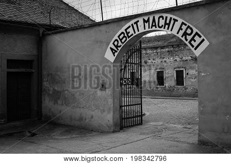 Terezin Czech Republic - July 5 2017: Arbeit Macht Frei (work liberates) - slogan in Terezin memorial the former concentration camp. Thousands of Jew people were murdered in the concentration camp Small Fortress by Nazis during WW2.