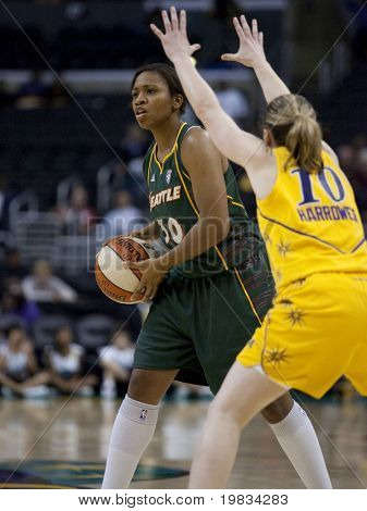 LOS ANGELES, CA. - SEPTEMBER 16: Tanisha Wright (L) trying to get past Kristi Harrower (R) during the WNBA playoff game of the Sparks vs. Storm on September 16, 2009 in Los Angeles.