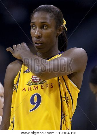 LOS ANGELES, CA. - SEPTEMBER 16: Lisa Leslie fixing her jersey during the WNBA playoff game of the Sparks vs. Storm on September 16, 2009 in Los Angeles.