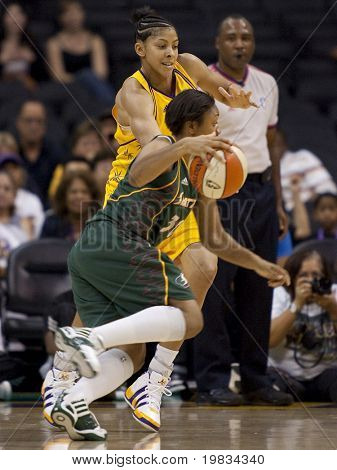 LOS ANGELES, CA. - SEPTEMBER 16: Candace Parker (in yellow) defending against Tanisha Wright (in green) during the WNBA playoff game of the Sparks vs. Storm on September 16, 2009 in Los Angeles.