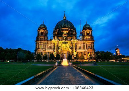 Berlin, Germany. View of Evangelical Cathedral located on the Museum Island in Berlin, Germany. Sunset with dark cloudy sky