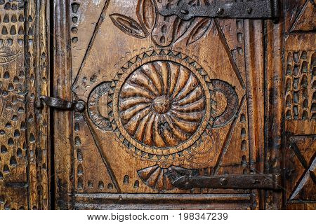 Old Wooden Engraved Door On Vintage Furniture